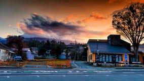 Yamanaka city with Mt. Fuji at dusk. YAMANASHI, JAPAN - MAY 01, 2017: Lake Yamanaka urban city With many traditional houses and restaurants during twilight sky Royalty Free Stock Photography