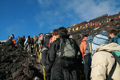 YAMANASHI, JAPAN - 29 JULY: Hikers waiting in line to get up the royalty free stock photo