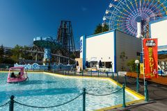 Fuji-Q Highland amusement park,Yamanashi. Yamanashi, Japan - May 01, 2017: Unidentified people riding watercycle with ferris wheel fun machine at Fuji-Q Highland Royalty Free Stock Images