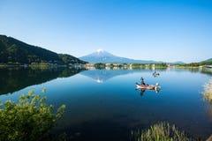 Mount Fuji, Fishing on Kawaguchiko lake. Yamanashi Prefecture, Japan-May 22, 2516- Fishing on Kawaguchiko lake and mount Fuji background stock image