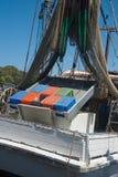 Yamba prawn boat. Yamba prawn boat in port with nets hoisted, vertical Stock Photo