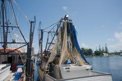 Yamba prawn boats. Yamba prawn boat in port with nets hoisted, vertical Stock Image