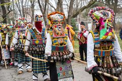 People in traditional carnival kuker costumes. Yambol, Bulgaria - February 24.2018: XIX International Masquerade Festival Kukerland 2018 The custom is widely Stock Image