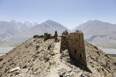 Yamchun Fortress in the Wakhan Valley near Vrang in Tajikistan. The mountains in the background are the Hindu Kush in Afghanistan. Central asia stock photo
