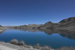 Yamdrok, calm Lake. A peaceful and beautiful reflection in the lake in Tibet stock photo