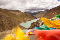Yamdrok lake and flags. Colorful flags beside the Yamdrok lake Stock Photos