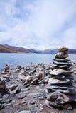 Yamdrok lake, Tibet. View of yamdrok lake with a lot of tibetan prayer-stone, Tibet Stock Images