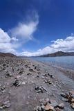 Yamdrok lake, Tibet. View of yamdrok lake with a lot of tibetan prayer-stone, Tibet Royalty Free Stock Photo