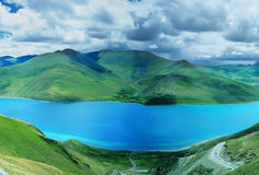 Yamdrok  lake in tibet. Yamdrok Tso Lake,located in Nagarze County, is at an altitude of 4,441 meters above sea level.it is 130 kilometers fromeast to west and Stock Photography