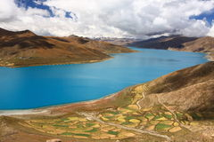 Yamdrok Lake in Tibet. Yamdrok Lake (also known as Yamdrok Yumtso or Yamzho Yumco) is a freshwater lake in Tibet, it is one of the three largest sacred lakes in Stock Images