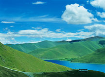 Yamdrok Tso Lake. Located in Nagarze County, is at an altitude of 4,441 meters above sea level.it is 130 kilometers fromeast to west and 70 kilometers from Stock Photography