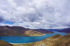 Yamdrok Yumtso lake,Tibet. The Yamdrok Yumtso lake,Tibet, Yamdroog is the fifth largest lake in the Tibet Autonomous Region and the largest inland brackish lake stock image