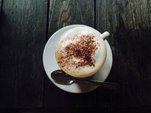 Yammi late. Beautiful latte on wooden table Royalty Free Stock Photography