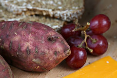 Yams, grapes, and cheese. Food display of yams, grapes, cheese, and bread Royalty Free Stock Photography