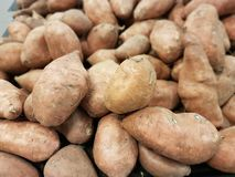 Yams in grocery stores and at home royalty free stock photo