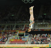 Yan Wang of China competing on the balance beam at women`s all-around gymnastics at Rio 2016 Olympic Games. RIO DE JANEIRO, BRAZIL - AUGUST 11, 2016: Yan Wang of Royalty Free Stock Image