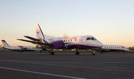 YanAir Saab 340 aircraft running on the runway Royalty Free Stock Image