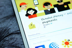 Yandex money mobile app. Downloading yandex money mobile app from google play store on samsung tablet royalty free stock image