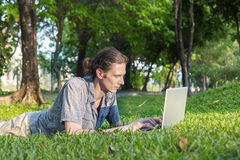 Yang business man working outdoors Stock Image