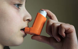 Yang girl holding asthma inhaler Stock Photo