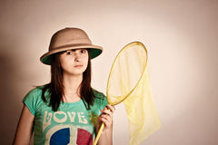 Yang girl with a net in a hat. Portrait of yang attrctive girl with net in her hands Stock Photo
