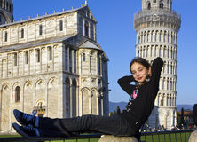 Yang girl recline on the tower of Pisa Royalty Free Stock Images