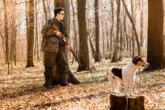 Yang hunter with a dog on the forest royalty free stock photography