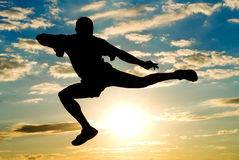 Yang man jumping to the sky Royalty Free Stock Photo