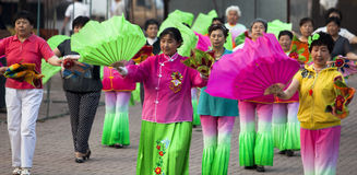 Yangko-A popular Chinese rural dance. Elders were performing Yangko, a popular Chinese rural folk dance, both for fun and health building. Performers usually Royalty Free Stock Image