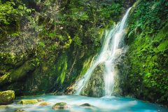 Xiao Yintang Waterfall of Yangmingshan National Park with milky cold spring and sunlight on sunny day, shot in Taipei, Taiwan. stock photography
