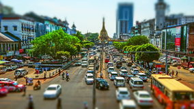 Yangon cityscape with busy highway and famous Buddhist shrine Sule pagoda. Myanmar (Burma). Time lapse, tilt shift effect. YANGON, MYANMAR - DEC 29, 2014: Yangon stock footage