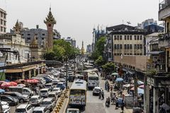 Busy downtown street view in Yangon and Sule Pagoda at the heart of Yangon city, Myanmar