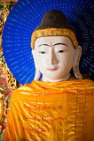 YANGON, MYANMAR - December, 14, 2010: Buddha statue at Shwedagon Royalty Free Stock Photography