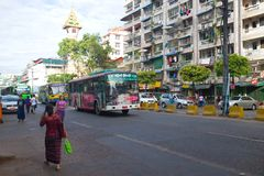 Route buses on city street, Yangon stock photography