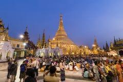 YANGON, MYANMAR, December 25, 2017: Shwedagon Pagoda with believers. In Yangon at dusk, Myanmar Burma Stock Image