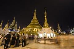 YANGON, MYANMAR, December 25, 2017: Shwedagon Pagoda with believers. In Yangon at night, Myanmar Burma Stock Images