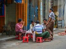 Burmese men drinking coffee on street royalty free stock photography
