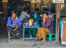 People drink coffee on street in Yangon, Myanmar royalty free stock photos