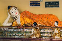 Yangon, Myanmar - FEB 19th 2014: Close up of golden buddha temple at Shwedagon Pagoda royalty free stock image