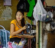 A woman tailor working at house royalty free stock photography