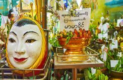 The face of Nat spirit, Sule Paya, Yangon, Myanmar. YANGON, MYANMAR - FEBRUARY 14, 2018: The egg shaped statue with smiling face Nat spirit in shrine of Sule Stock Photo