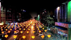 Bright New Year`s illumination in Yangon, Myanmar. YANGON, MYANMAR - FEBRUARY 14, 2018: Evening Maha Bandula road is lighted with many bright lanterns stock video
