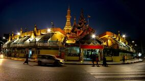 Evening Sule Temple, Yangon, Myanmar. YANGON, MYANMAR - FEBRUARY 14, 2018:  The evening view of golden Sule Pagoda, surrounded by market stalls and roundabout stock footage