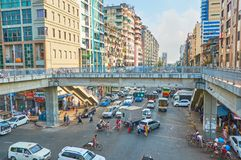 Hard traffic in Yangon, Myanmar. YANGON, MYANMAR - FEBRUARY 14, 2018: The pedestrian bridge on intersection of Anorata road and Lanmadaw street - always busy and stock images