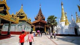 The medieval gate of Shwedagon, Yangon, Myanmar. Yangon, Myanmar - February 27, 2018: Pilgrims go to the North Gate of Shwedagon Pagoda, surrounded by numerous stock video