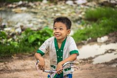 A cute Burmese boy face in a rural village outside the city. royalty free stock photos