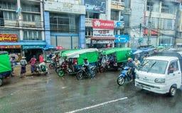 Yangon, Myanmar - June 23.2015: Traffic in Yangon, Myanmar by shooting through the windshield in Yangon, Myanmar in June 23.2015. royalty free stock images