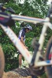 Young man cycling on a rural road and took pictures of nature along the way in the countryside on holiday. Yangon, Myanmar - June 06, 2016 : Young man cycling stock photos