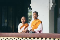 Yangon, Myanmar - March 2019: Buddhist female novice monks stand at the porch in Shwedagon pagoda stock images