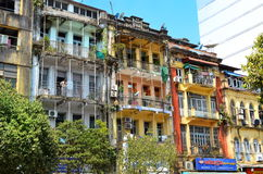 Yangon, Myanmar - March 9, 2015: A street archtecture view with colonial building in the town of Yangon. Yangon, Myanmar - March 9, 2015: A street archtecture Royalty Free Stock Image
